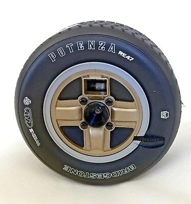 POTENZA, 110-cartridge tire-shaped camera.