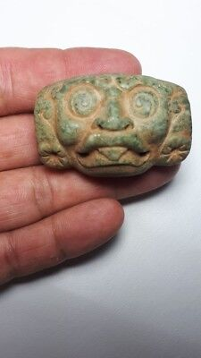 Pre-Columbian Mayan Jade bead of the god Kinich ahau from Guatemala. CA. 900 ad.