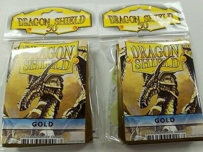 2 Packs of 50 - DRAGON SHIELD SLEEVES *GOLD* MADE FOR PLAYERS by PLAYERS