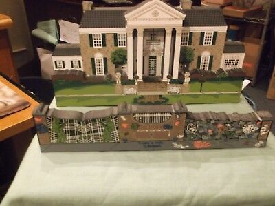 2 piece of Elvis Presley collectibles-- 1 is of Graceland Mansion and tthe Wall