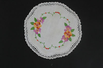 Vintage off-white round cloth with hand embroidered purple and orange flowers.