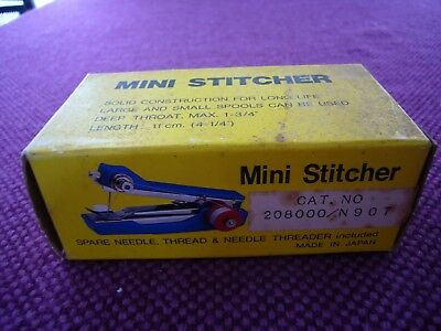 Vintage boxed Mini Stitcher. Hand sewing machine.  Made in Japan