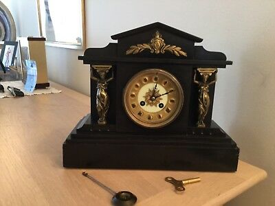 An  Early Slate Mantel Clock 1889 For Repair With Key And Pendulum Beautiful