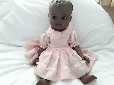 Vintage Soft Plastic Black Doll.  Original Clothing.  Likely 1950s or 60s