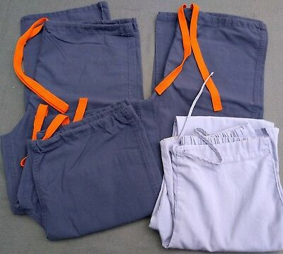 lot of four pairs women's scrubs in blue size small
