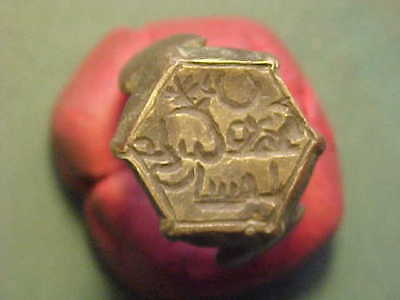 Ancient Egyptian bronze ring with script.