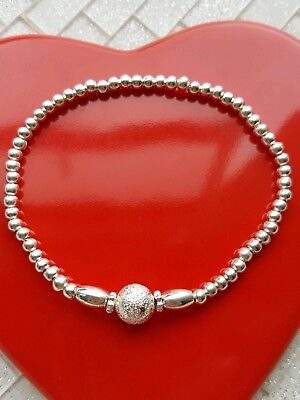 silver plated stretchy stacking bracelet with stardust charm bead