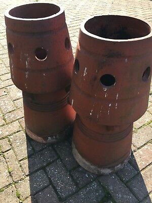 Reclaimed unusual red chimney pots.