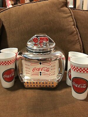 COCA-COLA COOKIE JAR JUKE BOX And  a set of diner style glasses (4) never used