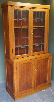 Early 20th Century Solid Oak Glazed Bookcase With Cupboard And Leaded Glass