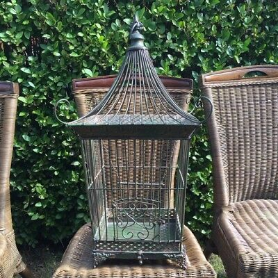 Ornate antique metallic bird cage
