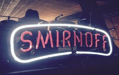 Vintage And Original Smirnoff Vodka Neon Liquor Sign Pops In A Dark Room