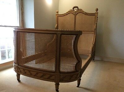 Antique French oak bergere bed. Recently restored and re-caned