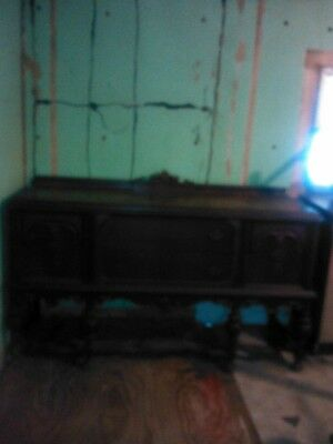 antique buffet with table and six chairs