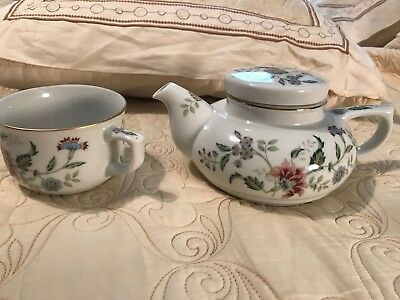 Andrea by Sadek Individual Teapot & matching cup floral pattern Cup rests on top