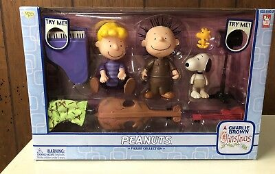 A Charlie Brown Christmas Peanuts action figure set. Snoopy, Schroeder, Pigpen