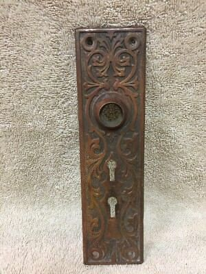 Antique Stamped Brass Victorian East Lake Doorknob Back Plate - Double Keyhole