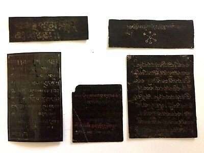 Antique Buddhist Amulets and Inscriptions - Gold on Black - Lot of various Items