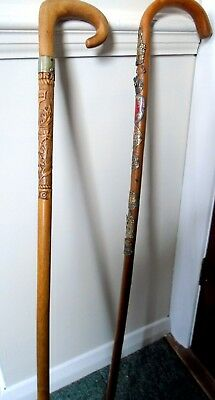 Two antique wooden walking canes,one carved Balmoral 1912,one German with badges