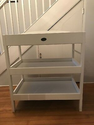 Used white Baby Weavers baby change table with 2 extra shelves