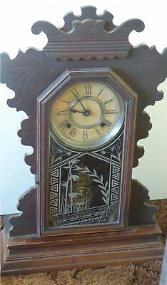 Antique Ansonia Gingerbread clock made in USA, working but chimes not...