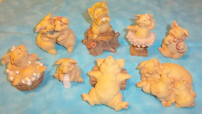 Collection of nine Pigsville pig figurines by Ganz