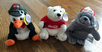 Three 1997 Coca Cola Beanies - seal, penguin, and polar bear - with tags