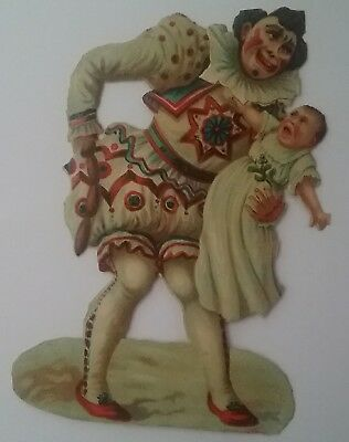 Embos Victorian Scrap, Clown holding sausages & a crying baby. 13x10cms see des
