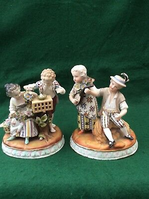 Antique pair of Continental figural groups (5.5 inches)