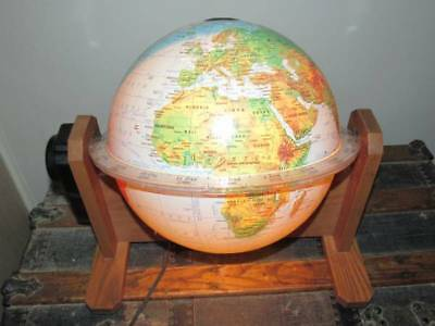Rotating Sunlit lighted world globe with oak stand George Cram