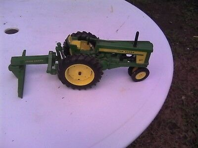 Toy John Deere 720 tractor and blade