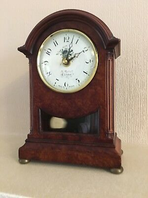 Mantel Pendulum Clock - 22.5cm high - wood case and brass trim.