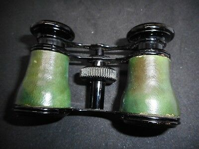 Opera glasses in soft, green leather case, Made in France.