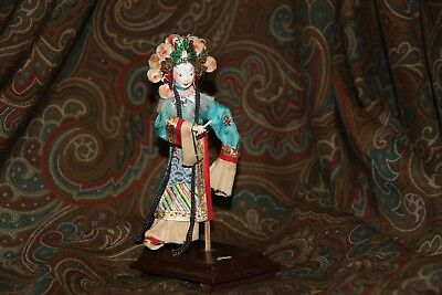 Antique Chinese doll on a wood stand, 6''