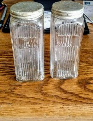 A pair of Clear Glass Spice Shakers Antique Vintage