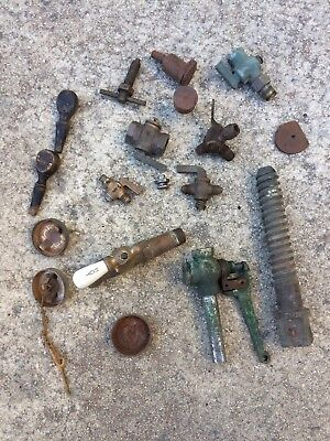 Antique hit and miss engine brass valves, parts, small engine gas caps.