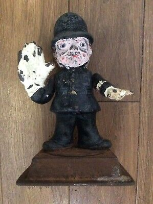 antique castiron police man with larg hand