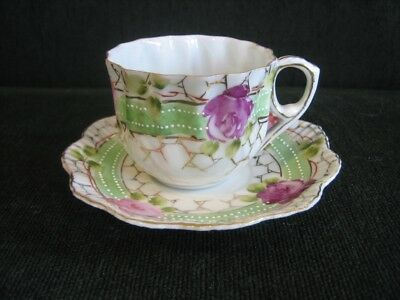 Beaded Nippon porcelain tea cup and saucer with fluted rims, vintage