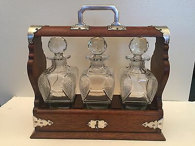 Antique Oak Tantalus With 3 Crystal Decanters