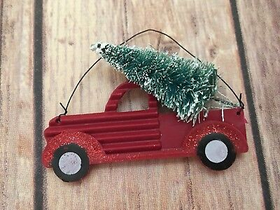 Red Pickup Truck with Christmas Tree Ornament