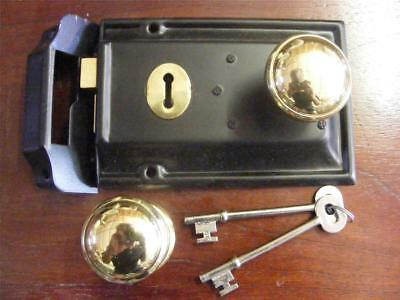 lane type black pressed metal rim lock and keeper,2 keys and 45mm brass knobs