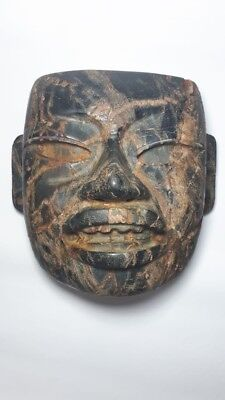 Pre-Columbian Olmec Stone mask from Mexico. 400 bc.