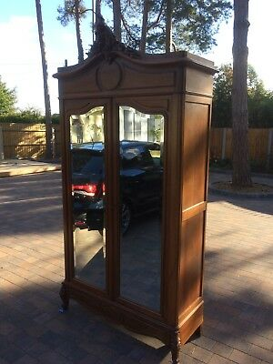 French antique vintage Louis XV style rococo mirrored oak wardrobe.