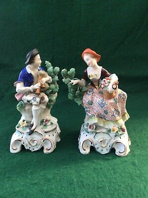 Antique Continental pair of porcelain figures (6 inches)