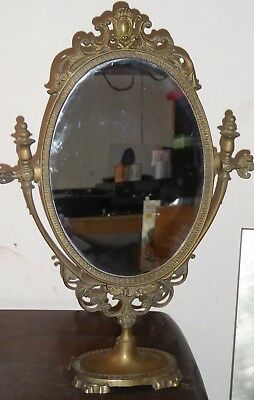 Antique brass ornate dressing table mirror on swivel stand