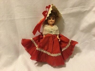 Vintage 1950's Tiny Doll With Red Dress And A White Shawl.