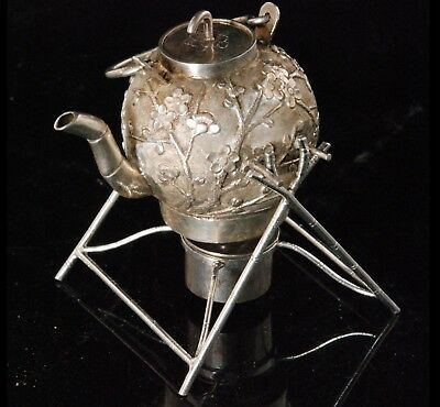 Chinese silver miniature spirit kettle decorated with applied prunus blossom