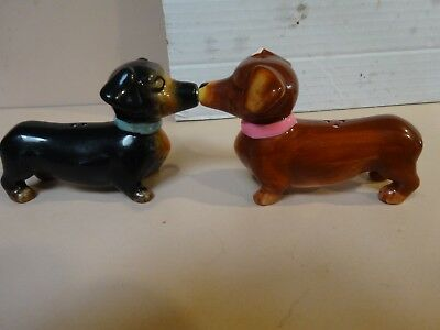 DACHSHUND novelty salt and pepper shakers with magnetic noses.