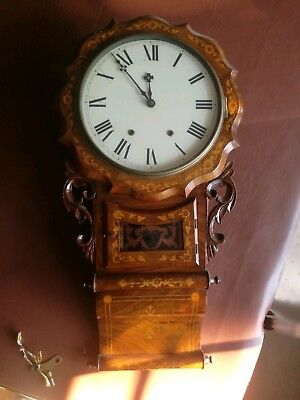 Antique American 8 day wall Clock. Size 32 inches high X 16inches wide max.