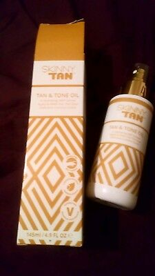 Skinny Tan - Tan and Tone Oil. Size 145ml - New in Box - Genuine